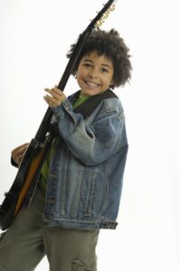 boy-playing-electric-guitar